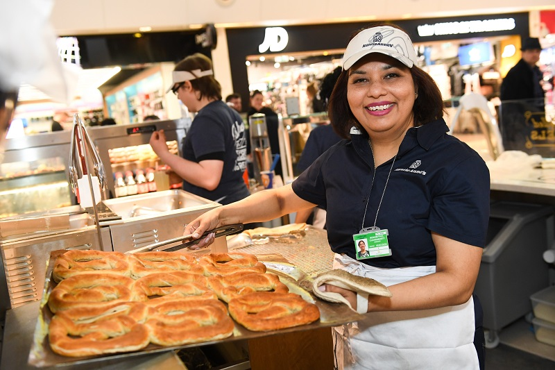 Auntie Annes staff member showing products