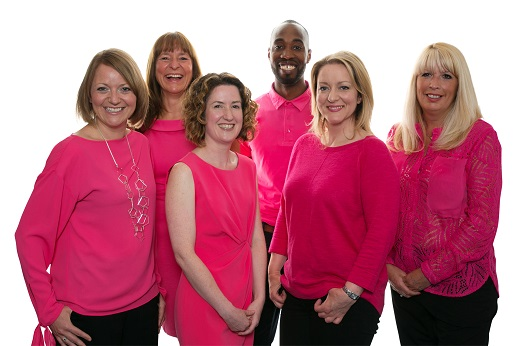 a group of Bright & Beautiful franchisees all wearing pink outfits