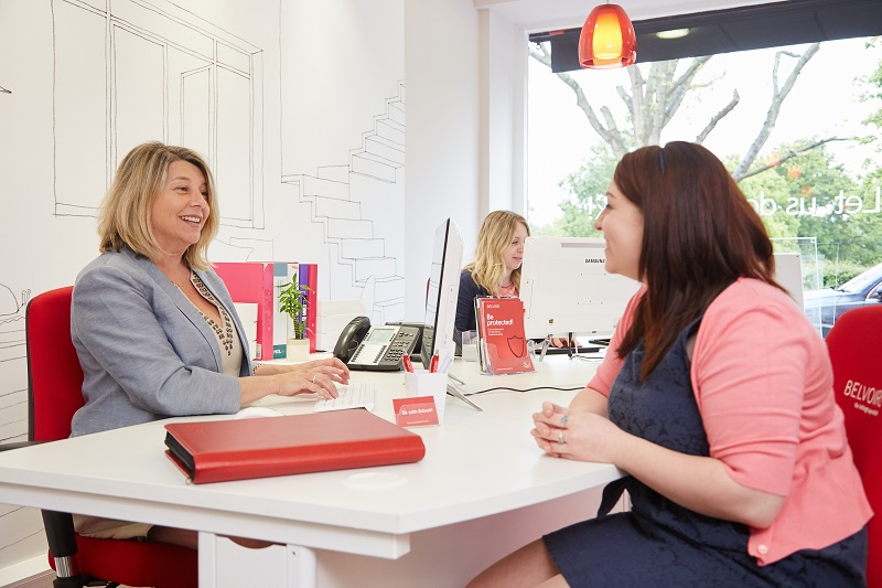 belvoir franchisee talking to a client with both sitting at a desk