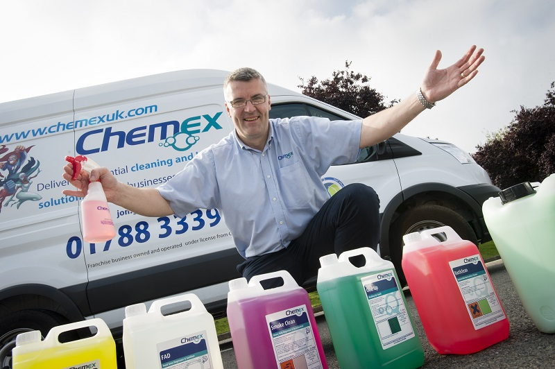 Chemex franchise owner with cleaning products outside his van