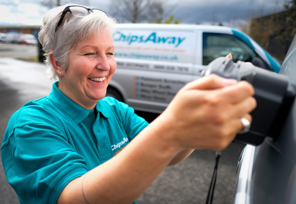 Chipsaway women franchisee fixing paint work on car