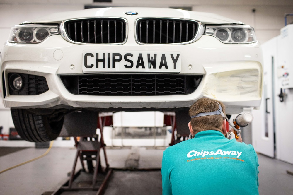 Chipsaway franchisee fixing car