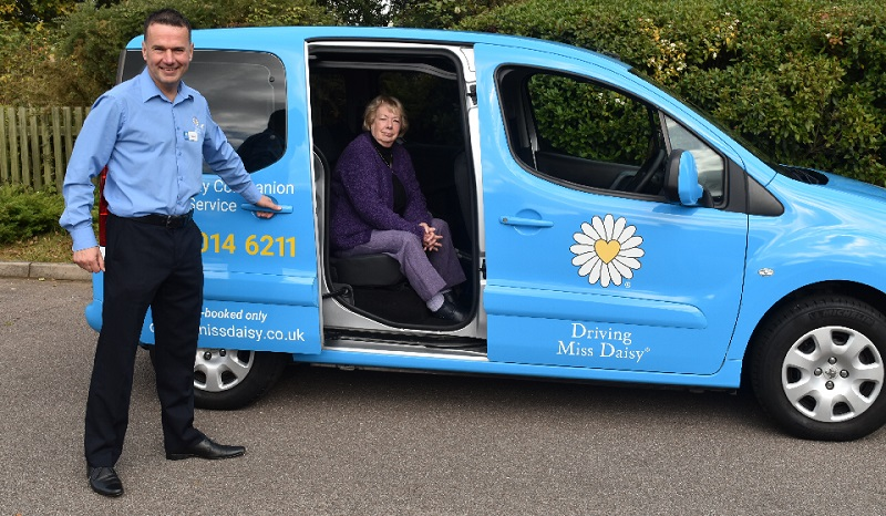 Driving Miss Daisy franchisee with elderly customer in van
