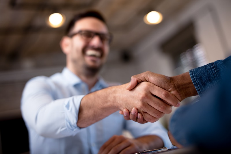ERA franchisee and client handshake