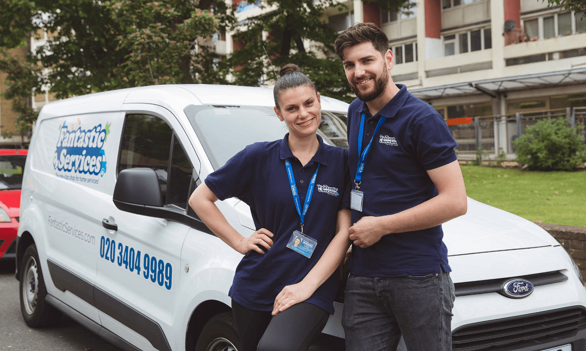 Two Fantastic Services Franchisees standing in front of a van