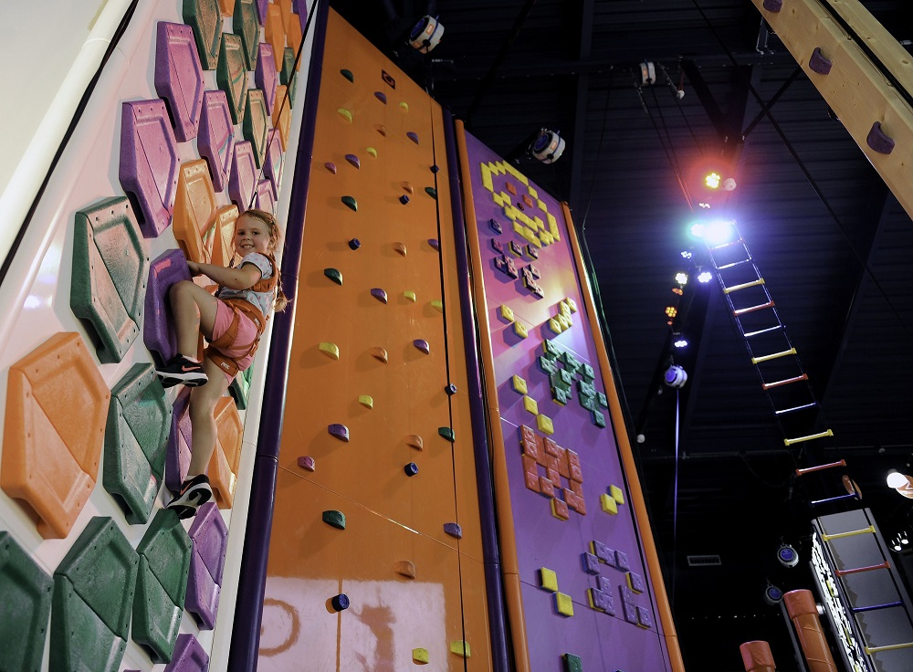 girl climbing wall at gravity
