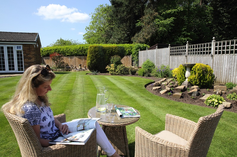 customer enjoying her Greensleeves treated lawn