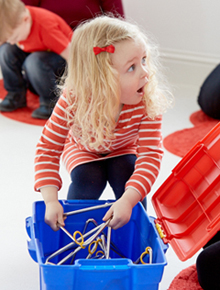 little girl playing musical instrument at jo jingles class