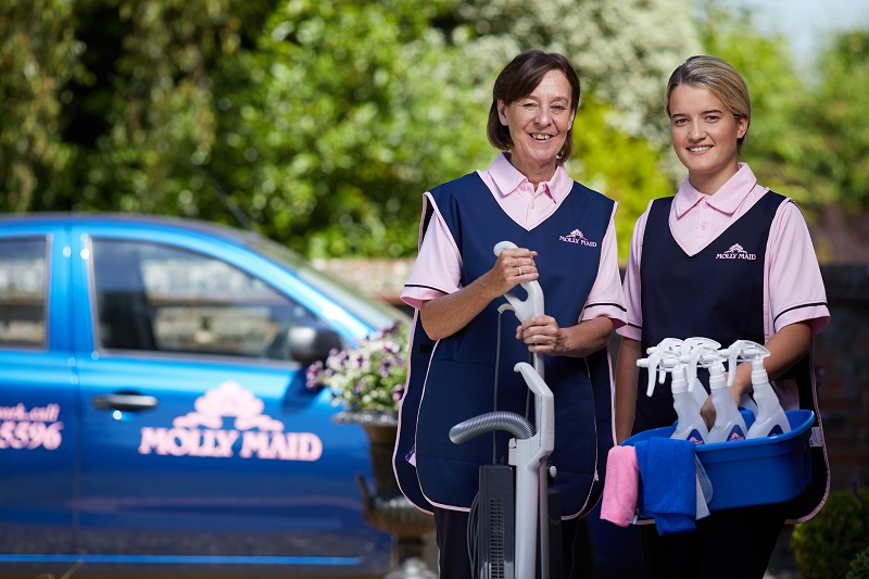 Molly Maid cleaners outside clients house
