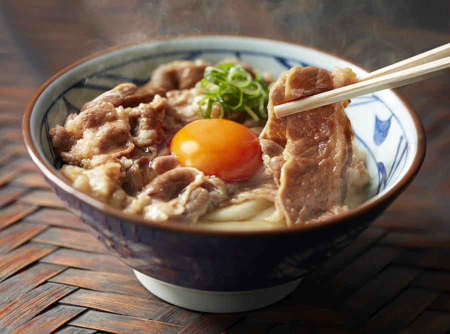 inside a Marugame Udon egg and beef dish
