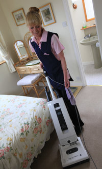 Molly Maid cleaner hoovering