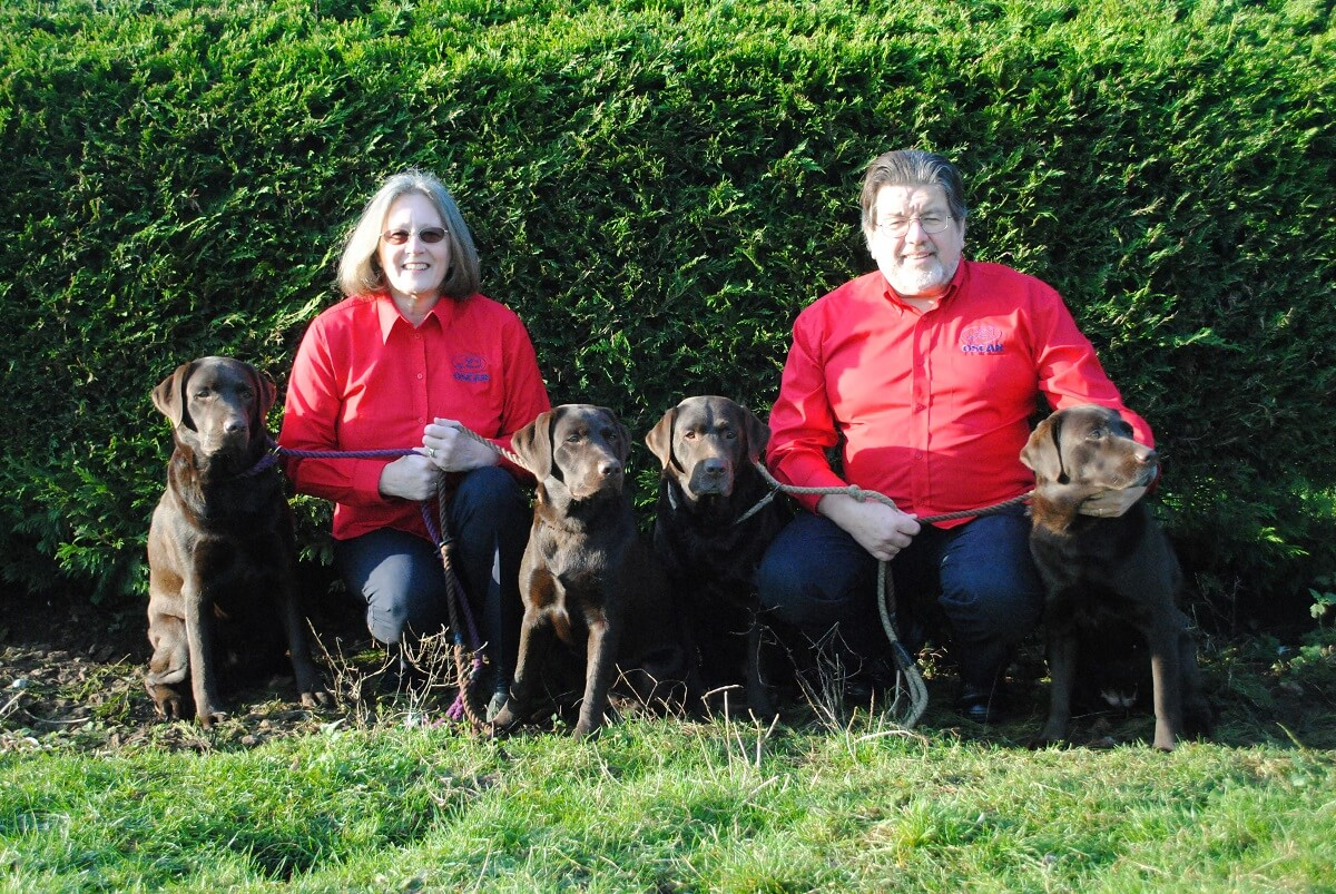 Oscars franchisees jill and steve with their dogs