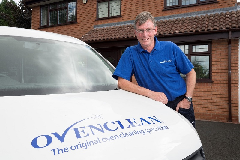 ovenclean franchisee standing by van