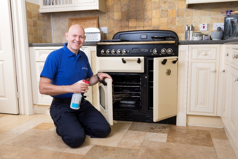 ovenclean franchisee cleaning an oven