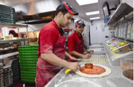 Papa Johns employees making pizza