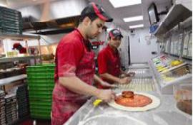 Papa Johns employees making pizza