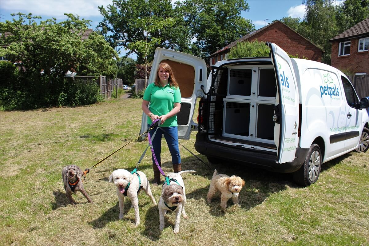 Petpals franchisee with dogs outside a van