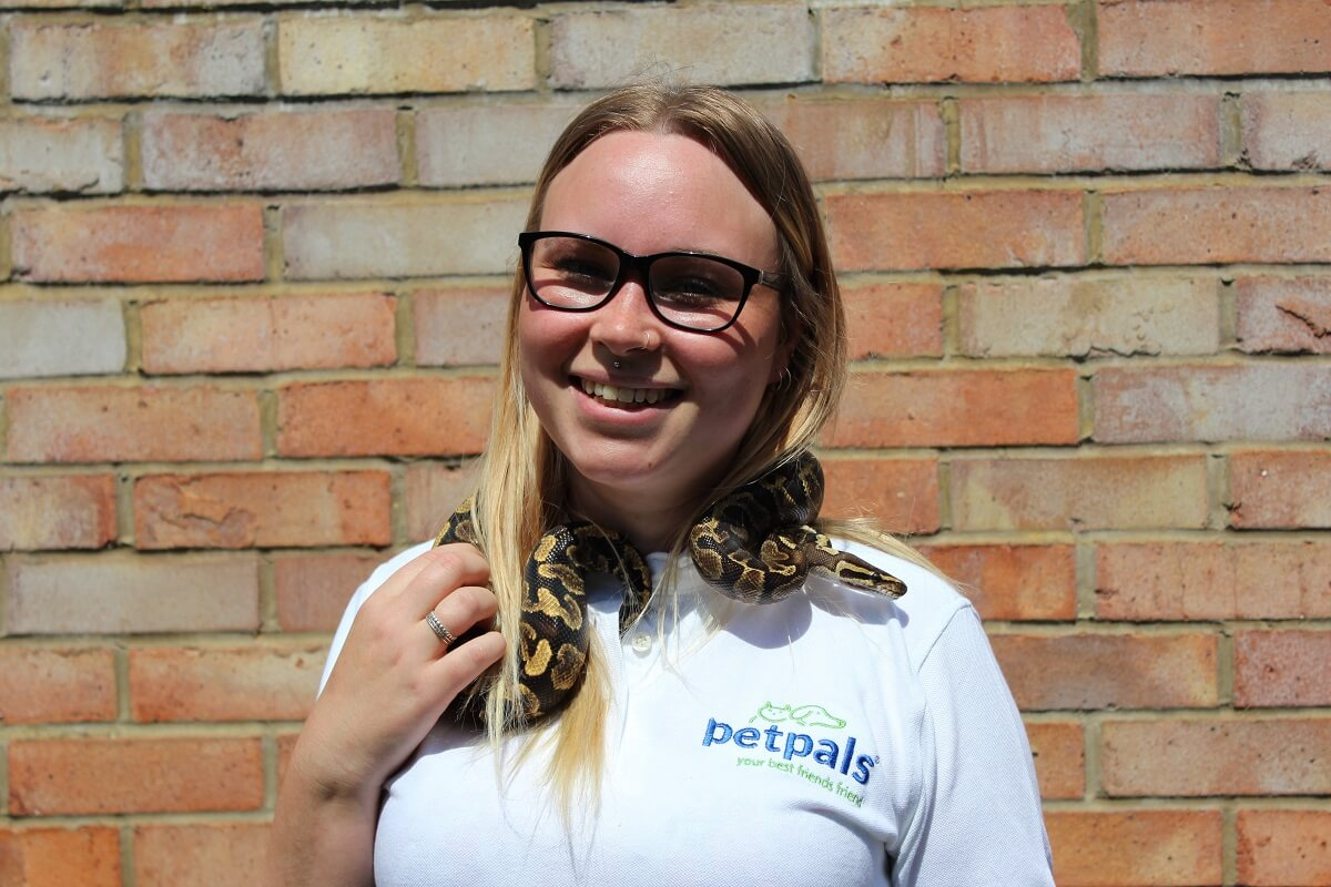 Petpals franchisees with snake wrapped around her neck