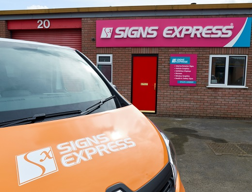 Signs Express van in front of warehouse