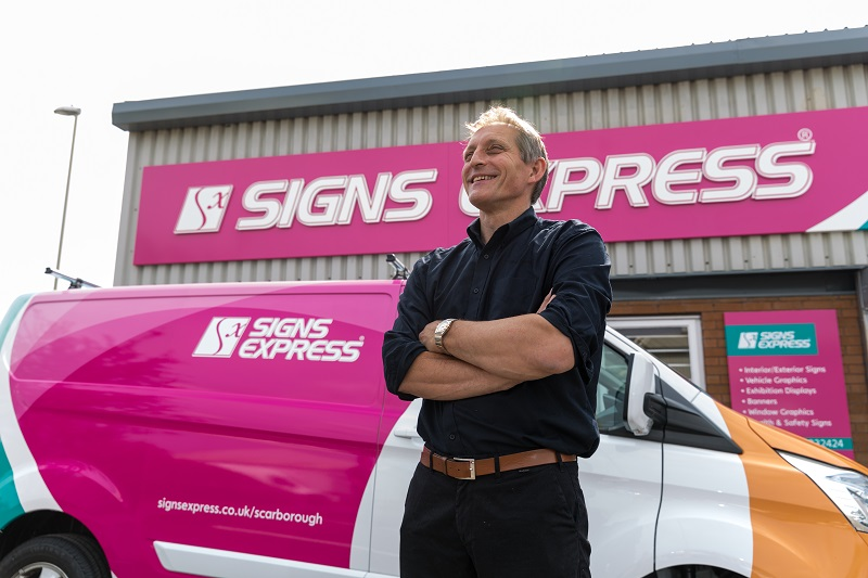 Franchisee standing next to his van outside his Signs Express centre