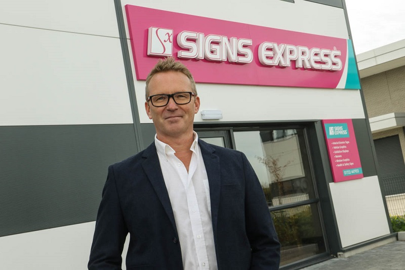 Signs Express franchisee standing outside of his sign centre