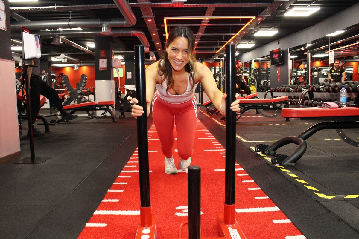 snap fitness gym goer pushing weights