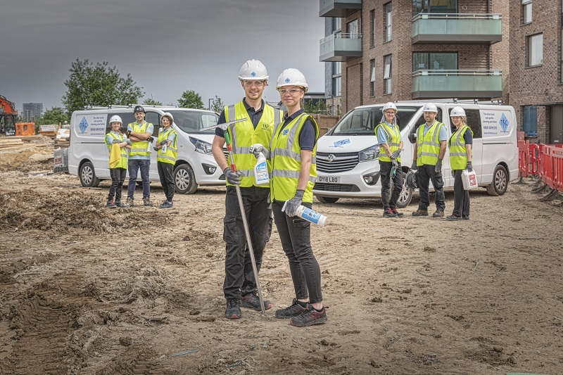 The Kleaning Company team next to their vans on a building site