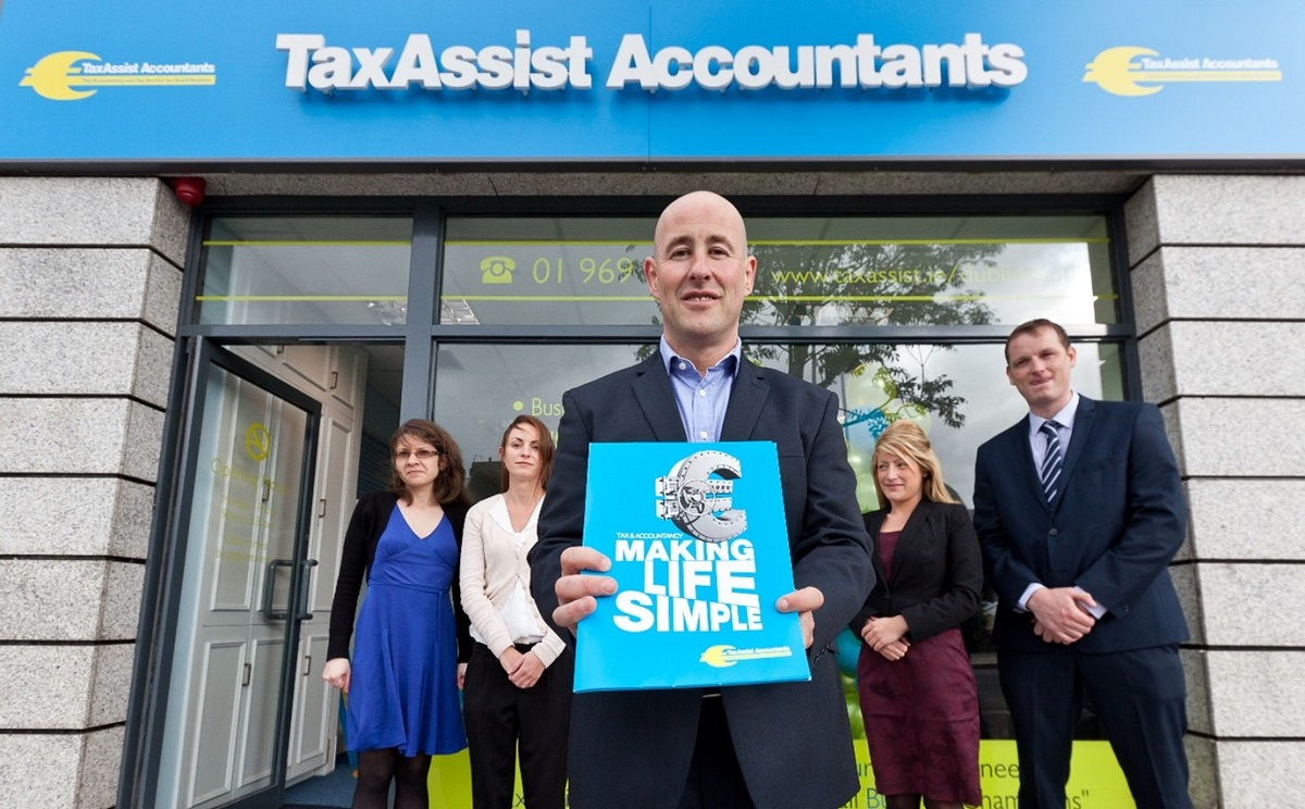 TaxAssist Accountants franchisee infront of their shop