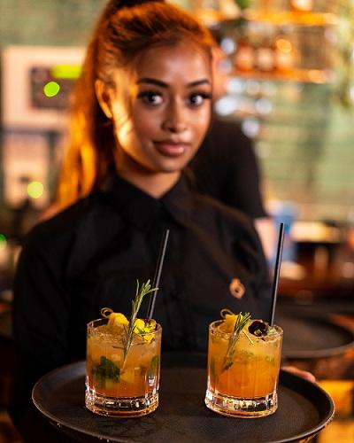 waitress in afrikana restaurant