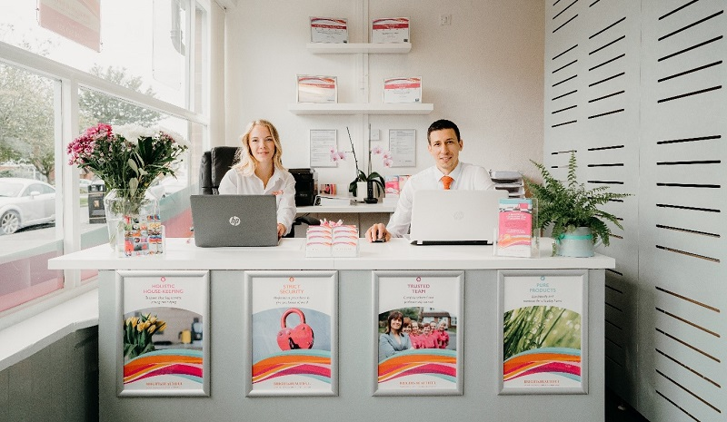 Bright and Beautiful employees sitting at a desk