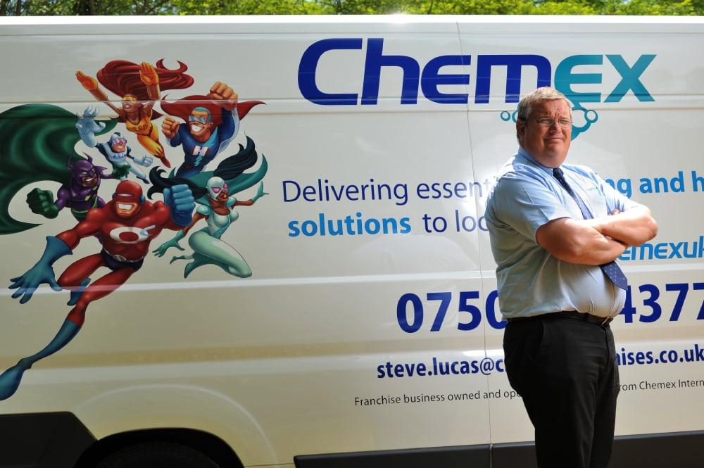 Chemex franchisee in front of van