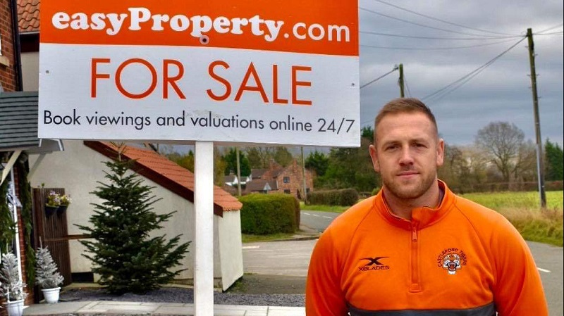easyproperty franchisee next to for sale sign