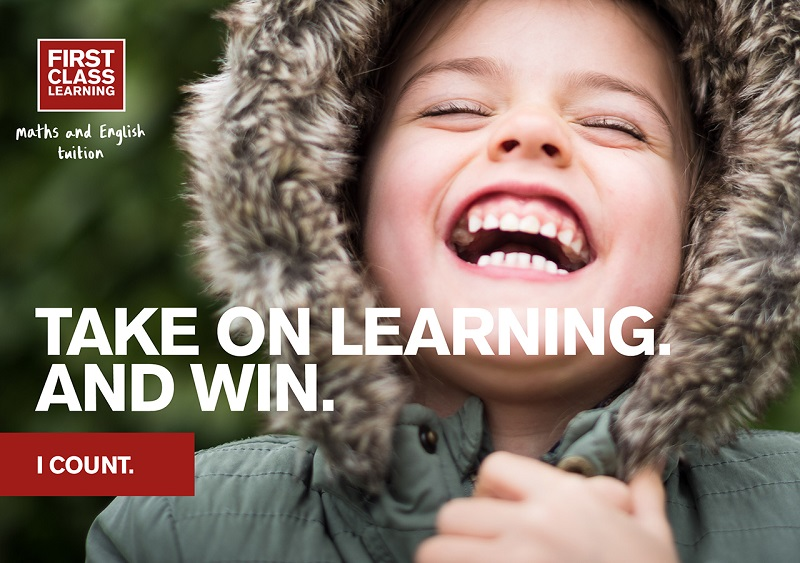 first class learning take on learning and win slogan next to child
