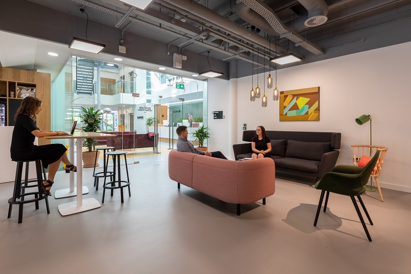 business meeting in open plan office showing flexible workspace with regus