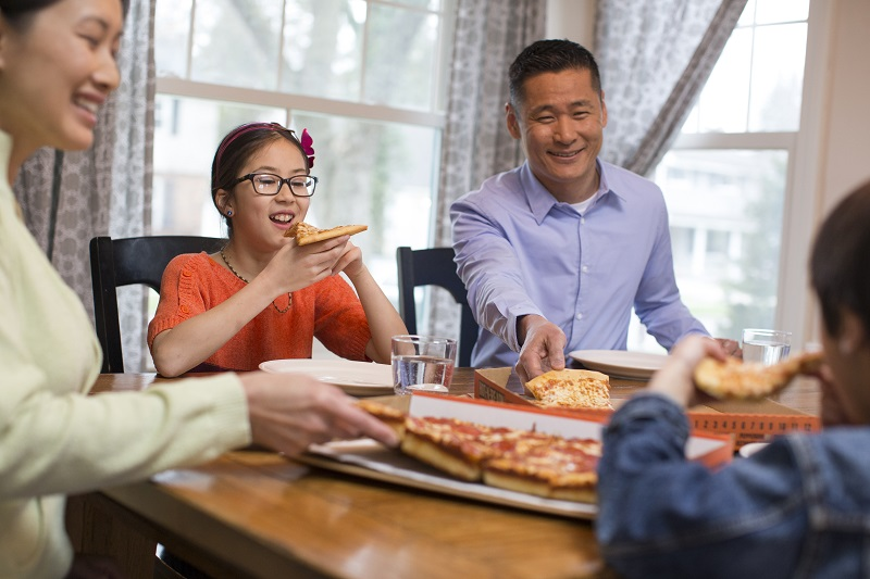 family enjoying Little Caesars Pizza