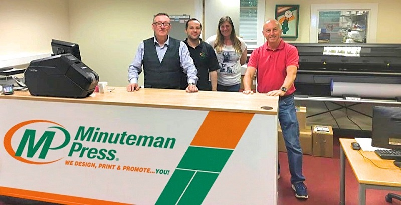 minuteman press franchisee and team in their print centre