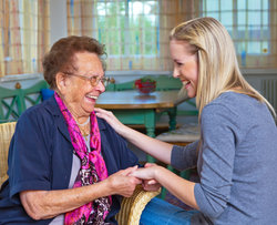Radfield laughing couple Radfield banner franchise business opportunity care carer senior support aged help elderly assistance lucrative industry home residential helper domiciliary service