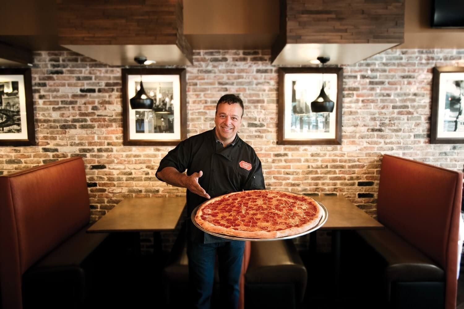russos founder anthony holding pizza
