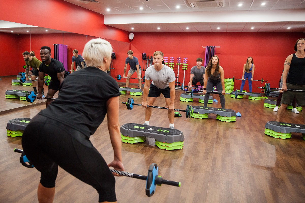 snap fitness gym goer working out with weights