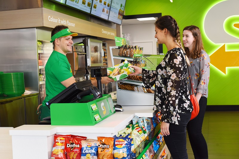 Inside a subway store showing customers getting served
