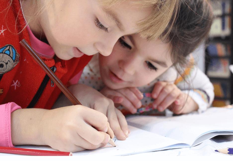 children tutoring together