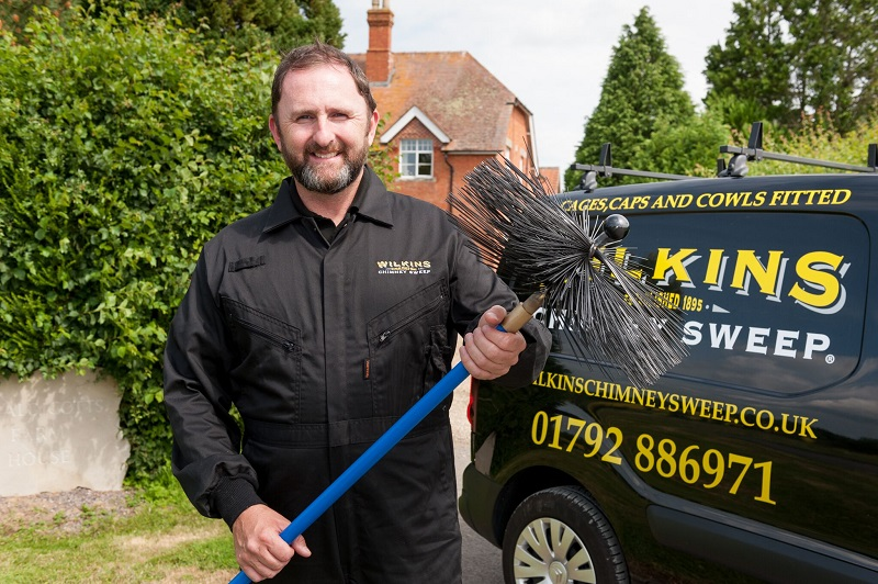 Wilkins chimney sweep franchisee next to his van