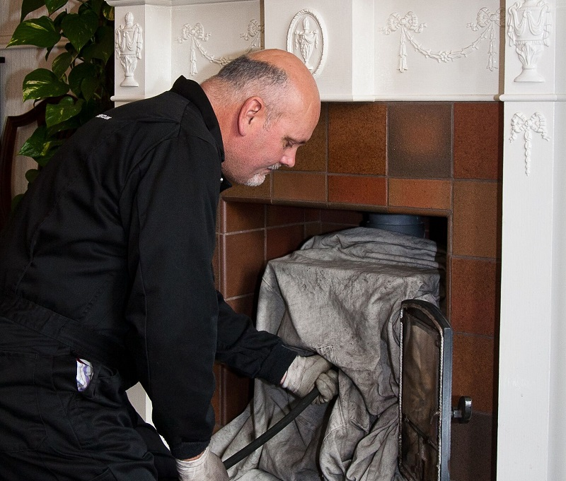 Wilkins chimney sweep franchisee cleaning a chimney
