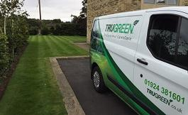 largetrugreen-van-and-lawn.jpg